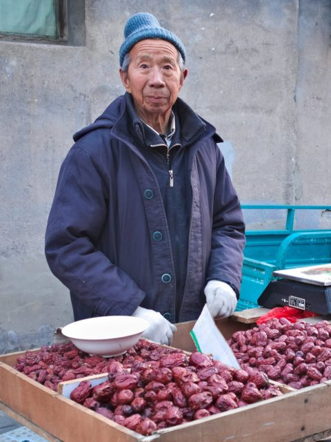 Beijing Street Scene, old man selling red dates