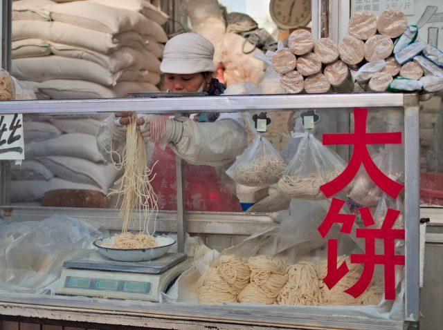 Beijing Street Scene, Woman Selling Noodles